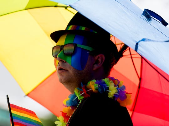 Jacob Uhl, of Knoxville, watches as the parade passes during the annual Knoxville Pridefest Parade in downtown Knoxville, Tennessee on Saturday, June 23, 2018. This year's parade was expected to be the largest one to date.