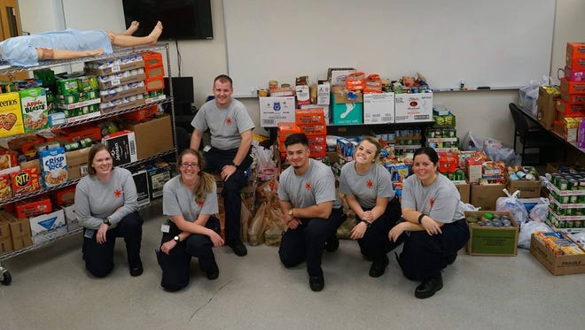 Pensacola State EMT students collected 4,000 pounds of goods for Manna at the fourth annual Fill the Ambulance food drive. Shown from left: Jennifer Boardwyne, Angela Thompson, Brock Daily, Noah Sanchez, Cindy Columbia and Thela Cordero.