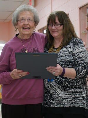 Volunteers-1 - Deming Luna County Senior Citizens Center Director, Barbara Rios (right) presents an award to Virginia Poole for 10 years of volunteer service at the annual volunteer thank you breakfast on Friday. 