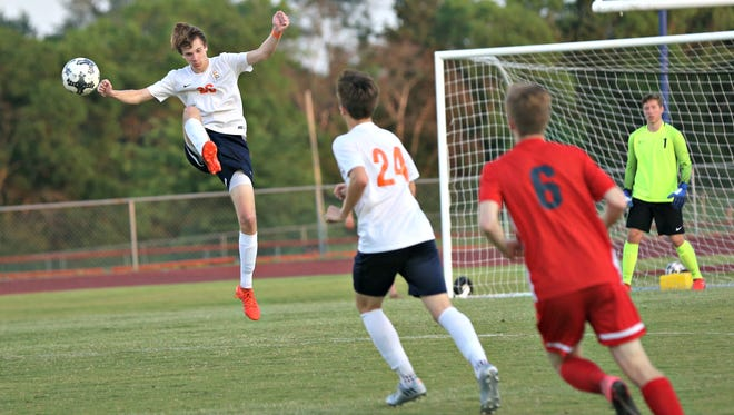 Blackman defender J.C. Conn leaps to stop a pass heading toward the Blaze goal during Thursday's Region 4-AAA finals.
