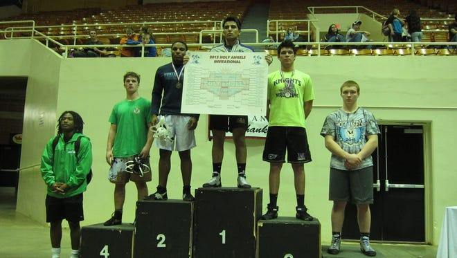 North Henderson's Celedonio Cardenas placed third in his weight class at the Holy Angels Invitational in Charlotte.