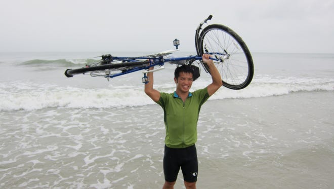 North Henderson wrestling/girls track coach Heang Uy biked across the United States in 2010.