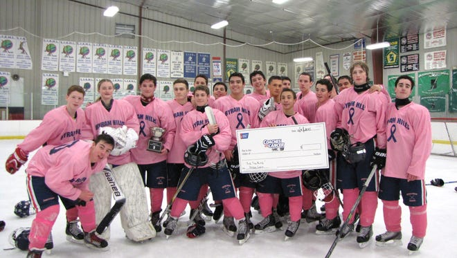 Byram Hills raises money for the American Cancer Society with its annual Pink the Rink game.