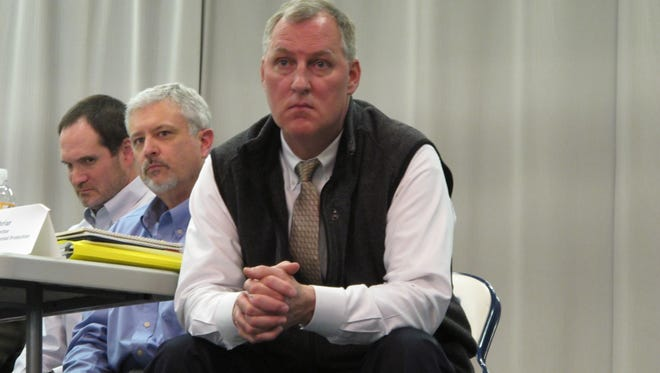 Jon Maybriar, assistant director of the Kentucky Department for Environmental Protection, listens to comments at a public meeting in Irvine on March 1.  Advanced Disposal executive Dave Retell, at left, and Danny Anderson, with the Kentucky Division of Solid Waste, listen in.