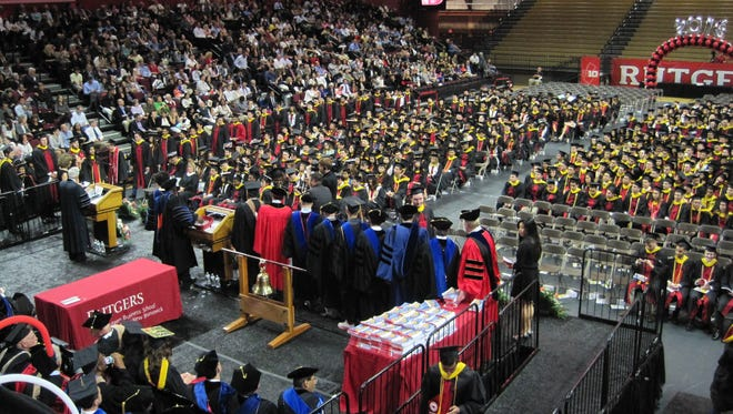 Patrick Bender, of Stanhope, receives his diploma Friday, May 13, 2016, at the Rutgers Athletic Center, Piscataway, during the commencement ceremony for Rutgers Business School - New Brunswick graduates.