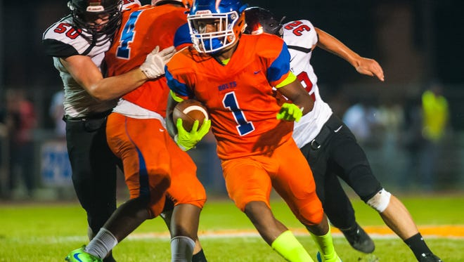 Millville wide reciever Carlton Lawrence (1) works up field against Kingsway at John Barbose Stadium in Millville on Friday, September 15.
