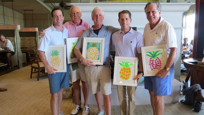 The overall winner of the Pro Am was Roger Lynch's team with Roger Lynch Jr., left, Mike McManus, Roger Lynch, Red Stick's pro Ryan Sharpe, and Rick McDermott. Players on winning teams received custom artwork created by Boys & Girls Club members.
