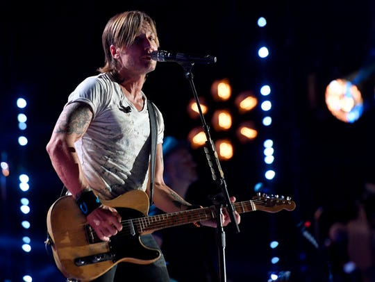 Keith Urban performs during the CMA Music Festival on Sunday, June 11, 2017, at Nissan Stadium in Nashville.