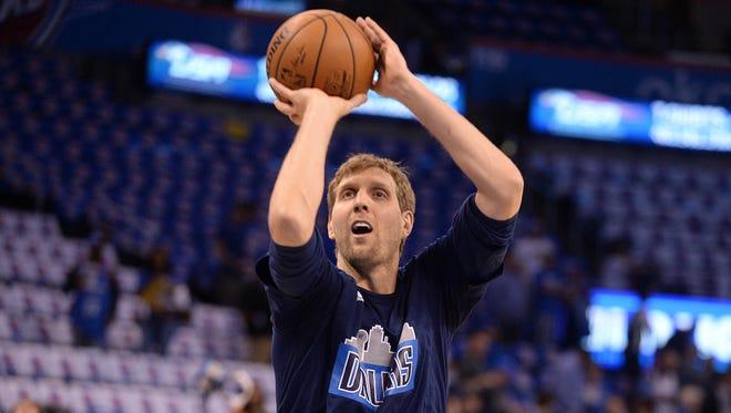Dallas Mavericks forward Dirk Nowitzki (41) shoots during warm ups prior to game one of NBA playoffs against the Oklahoma City Thunder at Chesapeake Energy Arena.