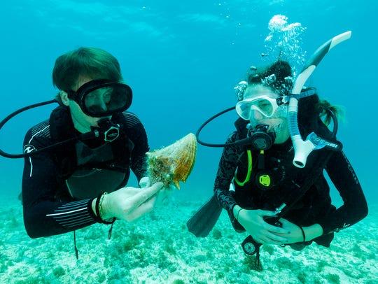 Carmen Hoyt, right, dives with Philippe Cousteau Jr.