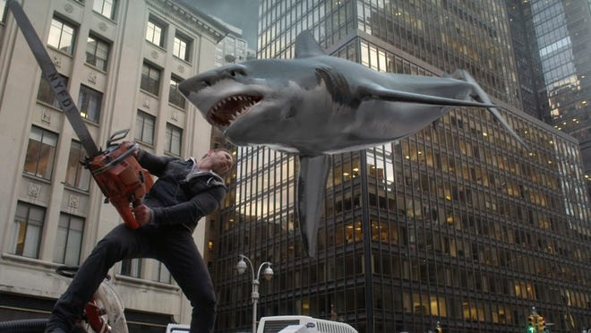 """This photo released by Syfy shows Ian Ziering as Fin Shepard  in a scene from the TV series, """"Sharknado 2: The Second One.""""  (AP Photo/Syfy) ORG XMIT: CAET407"""