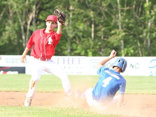 Huntingdon's Kelby Pearson (4) slides into second base against McKenzie in the District 11-A title game May 10, 2018.