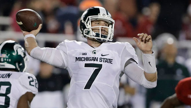 Michigan State quarterback Tyler O'Connor (7) throws during the first half Saturday in Bloomington, Ind.
