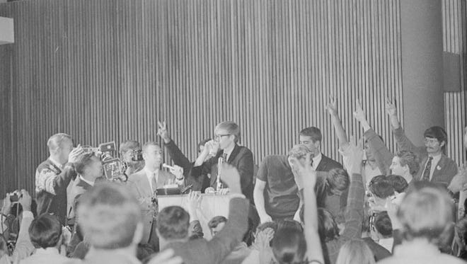 """CSU student body president Doug Phelps chugs a beer in front of classmates during a """"drink-in"""" demonstration on the campus in 1968."""