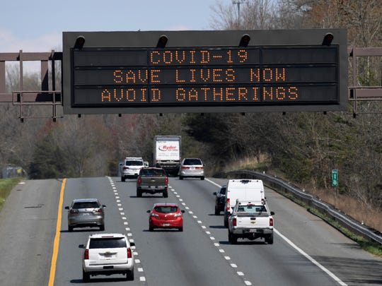 A sign about the coronavirus is displayed over Route 50 in Davidsonville, Md., on Monday.