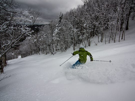 A skier charges down Bolton Outlaw on a powder day.