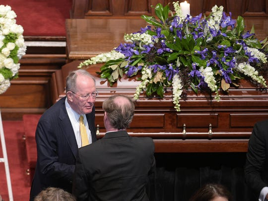 Sen. Lamar Alexander pays his respects to Sen. Douglas Henry's family members during Henry's funeral service at the Downtown Presbyterian Church in Nashville on Friday, March 10, 2017.