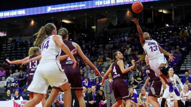 Northern Iowa's Sharnae Lamar drives to the basket against the Missouri State defense during second half Sunday in the Missouri Valley Conference championship game.