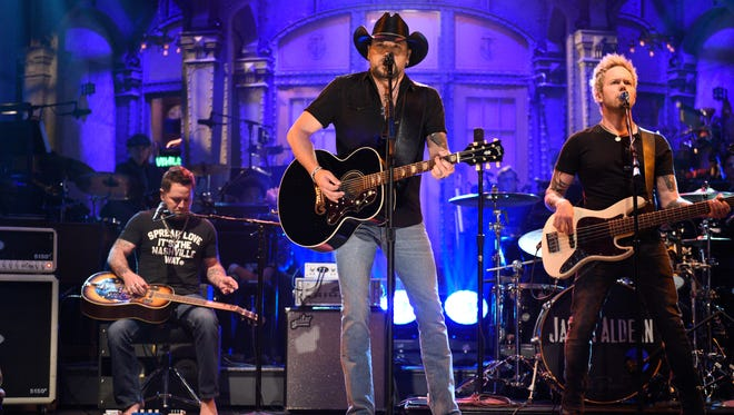 Jason Aldean performs 'I Won't Back Down' on 'Saturday Night Live,' on Oct. 7, 2017, in New York. 'Saturday Night Live' paid tribute to the victims of the Las Vegas mass shooting and the late rock superstar Tom Petty by opening its show with country star Aldean singing one of Petty's songs.