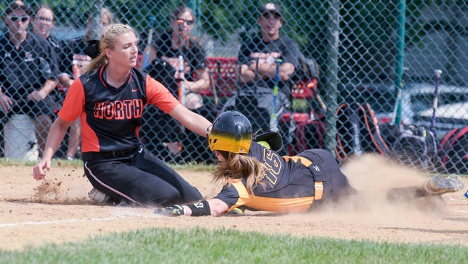 A Shore Conference Tournament semifinals  softball game between Middletown North and St. John Vianney was played at Wall Township High School on Saturday, June 4, 2016. Riley Kernan of MN tags out Anne Manganiello (16) on a close play at home plate. /Russ DeSantis for the Asbury Park Press / Slug:ASB 0605 sct softball semis MN-SJV