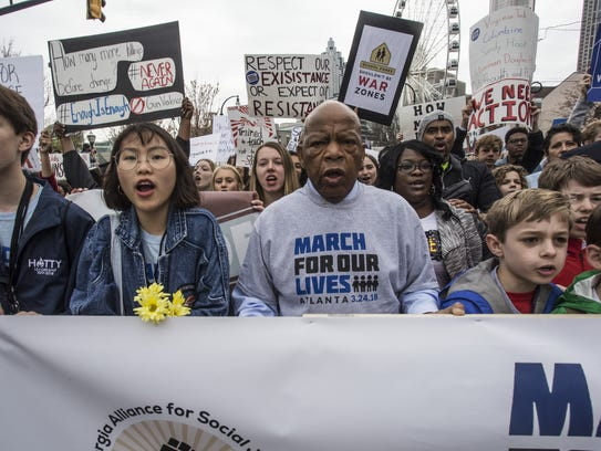 U.S. Rep. John Lewis leads a march of thousands through