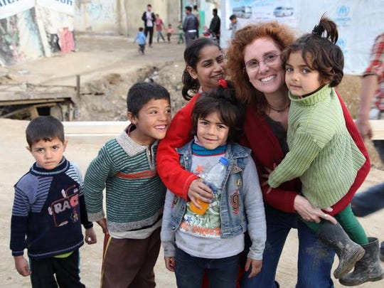 """Lebanese-American Barbara Abdeni Massaad produced a humanitarian cookbook, 'Soup for Syria,"""" to help Syrian refugees like these."""