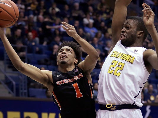 Oregon State's Stephen Thompson Jr., left, shoots against California's Kingsley Okoroh during the first half of an NCAA college basketball game Friday, Feb. 24, 2017, in Berkeley, Calif. (AP Photo/Ben Margot)