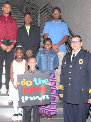 Do the Right Thing Award recipients: Holding sign: Luis Delgado. Middle, left to right: Latifah Wade, Jadaya Matthews, Rochester Police Chief Michael Ciminelli. Top, left to right: Kenneth Cruz, Ja-mes Beckford, Jailen Griffen.
