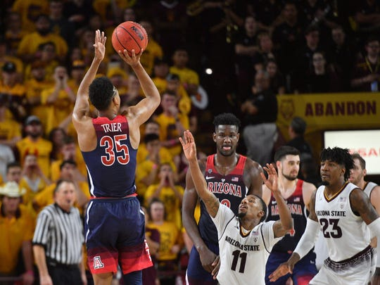 Arizona State guard Shannon Evans II (11) stands just 6-foot-1. So does his backcourt mate, Tra Holder. Their size could hurt the Sun Devils defending SU's big guards and trying to get shots off.