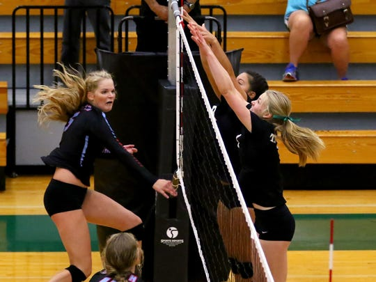 South Salem's Bridgette O'Connor gets the ball past a pair of West Salem defenders during a Greater Valley Conference match, Tuesday, September 15, 2015, in West Salem, Ore. West Salem won 3-0.
