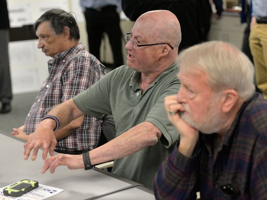 Local veteran Mike Mills offers comments during the