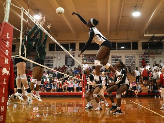 Leon's Shania Cromartie spikes the ball against Lincoln during the Lions' District 2-8A final win at home on Thursday, Oct. 19, 2017.