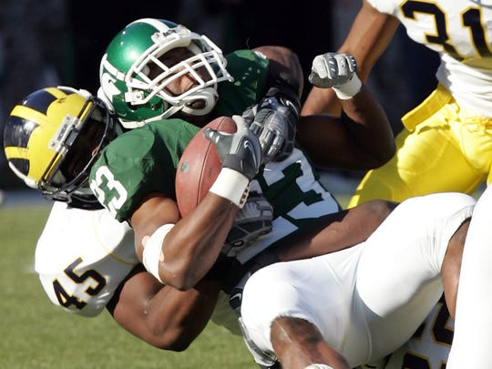 Obi Ezeh for Michigan makes a tackle against Javon Ringer for Michigan State in 2007.