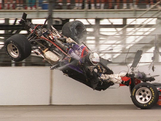 FILE – Stan Fox, his legs exposed, sits in his airborne car after slamming into the first turn wall on the opening lap of the 1995 Indy 500. Fox's car had collided with Eddie Cheever's, right, both hitting the wall.