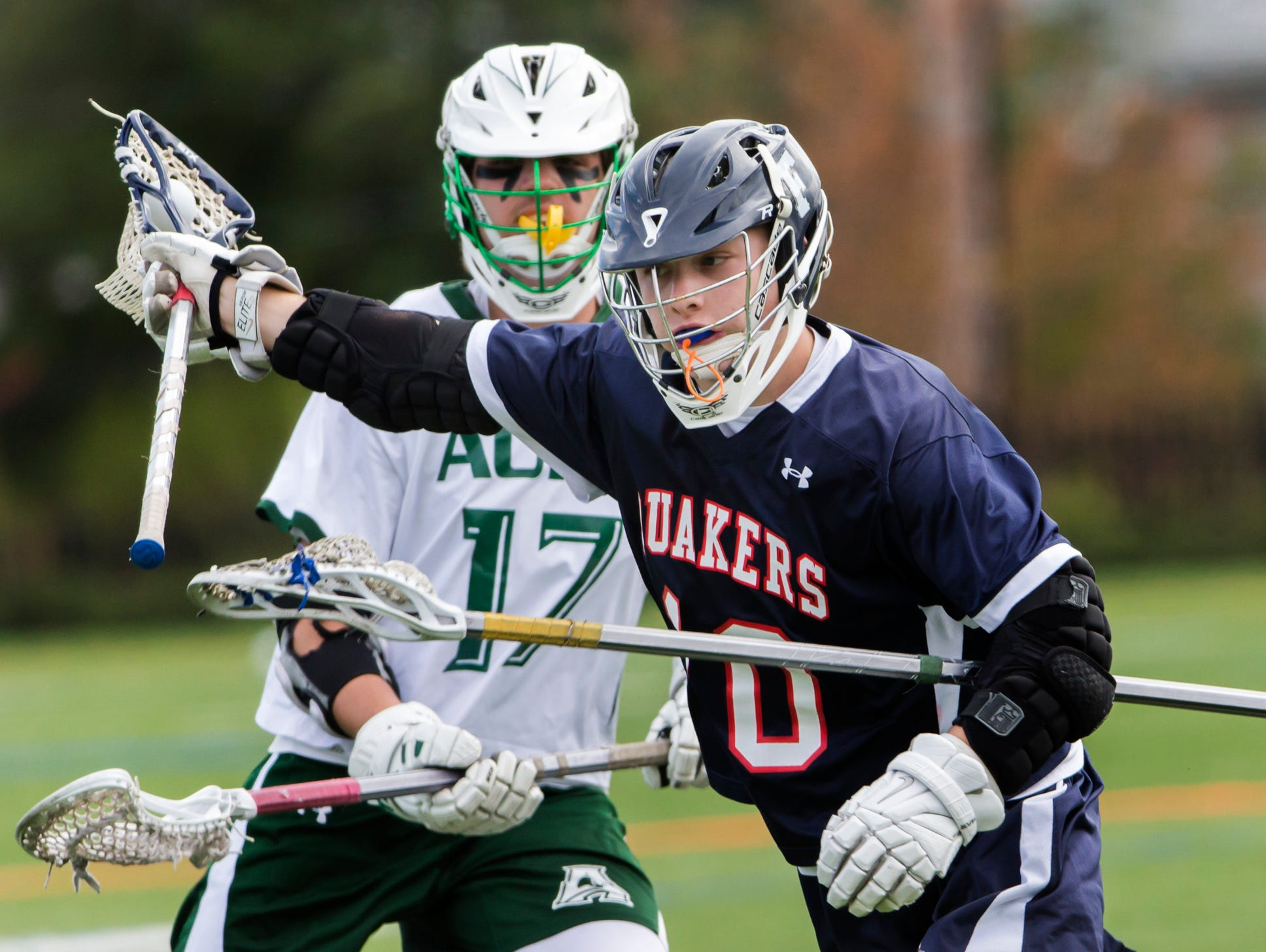 Friends' Eric Pincus cuts toward the goal ahead of Archmere's Jackson Singewald in Archmere Academy's 13-8 win over Wilmington Friends School at Archmere on Thursday afternoon.