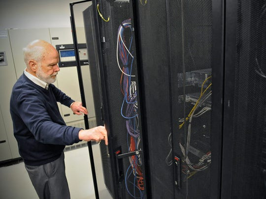 Two of the St. Cloud Area Quarterly Business Report's special questions deal with the response area business owners had to cybersecurity. In this 2015 photo, Alan Roebke explains the importance of cybersecurity and data centers at the Alexandria Vaultas data center.