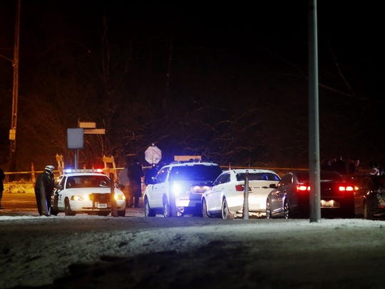 Police investigate the scene of an officer-involved shooting near Sunset Avenue and Rapid Run Road in West Price Hill Monday.