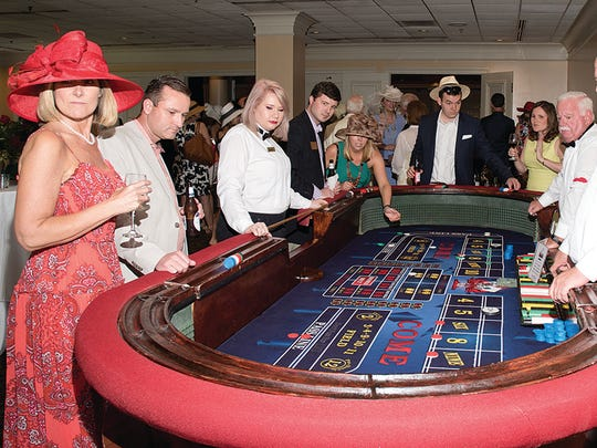 "Guests at the Derby Party for Hospice of Montgomery up'd the ante on extra fun, playing with ""funny money"" at gaming tables (Courtesy of Patricia White Photography)"