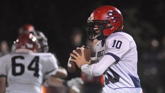 Byram Hills quarterback Brett Stafford scrambles while