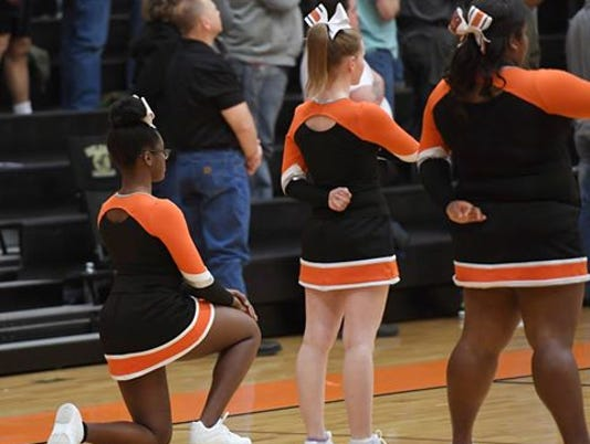 636172275395134534-cheerleader-kneeling.jpg