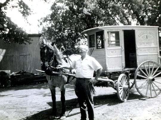 William A. Liebert is shown in a book photo with his horse, Patsy, and milk wagon at Liebert Bros. Dairy, 2141 Lexington Road, now the site of apartments.