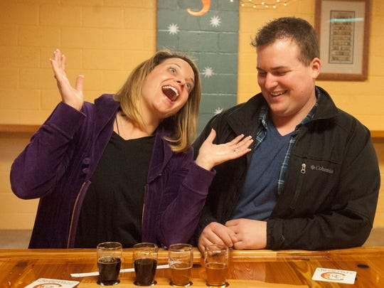 Sara McGuinness and Mark McGuinness enjoy a selection of beer at the Spellbound Brewing in Mount Holly.