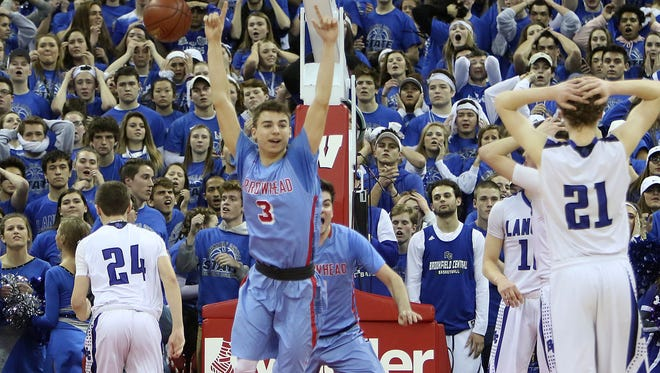 Arrowhead's Marko Matejic (3) reacts between Brookfield Central's Charlie Debbink (24) and Chris Post (21) at the end of the teams Division 1 WIAA Boys State Basketball Tournament Semi-Final Game in the UW Kohl Center Friday, March 17, 2017, in Madison, Wisconsin.