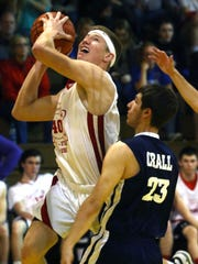 Buckeye Central's Grant Loy shoots for the basket in