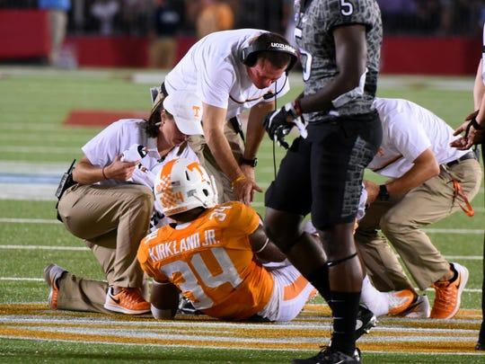 Tennessee head coach Butch Jones checks on injured linebacker Darrin Kirkland Jr. (34) during second half of their 45-24 victory over Virginia Tech at The Battle At Bristol Saturday, September 10, 2016 in Bristol, Tenn. (MICHAEL PATRICK/NEWS SENTINEL)