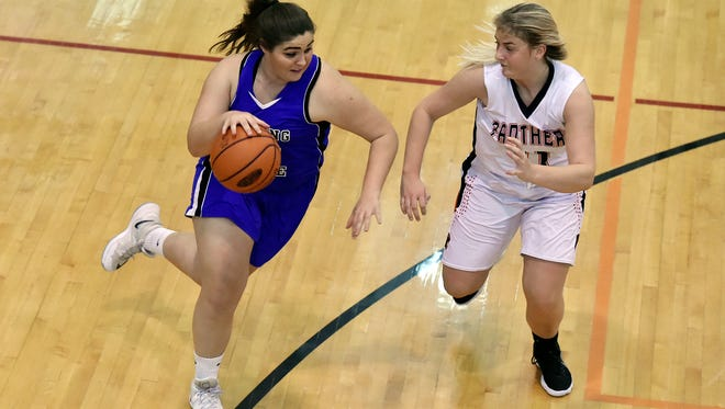 Spring Grove's Ashton Ball drives against Central York's Nikson Valencik in the first half of a YAIAA girls' basketball game Friday, Jan. 12, 2018, at Central York. Central York defeated Spring Grove 49-32.