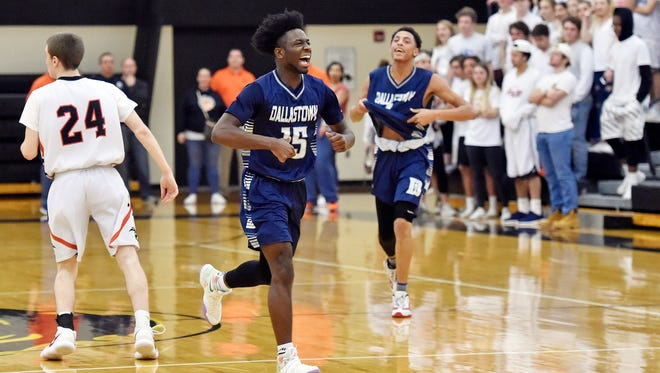 Dallastown's Da'Trail Albert, center, reacts at the final buzzer in the second half of a PIAA District 3 first-round boys' basketball game Wednesday, Feb. 21, 2018, at Red Lion. Dallastown overcame an 18-0 deficit to defeat Central York 58-53 to advance in the tournament. The game was originally scheduled to be played at Central York, but was moved to Red Lion after police investigated threats to Central York schools, which were closed Wednesday.