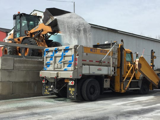 A state Department of Transportation plow truck is loaded with salt Monday, March 13, 2017, in preparation for a winter snow storm.