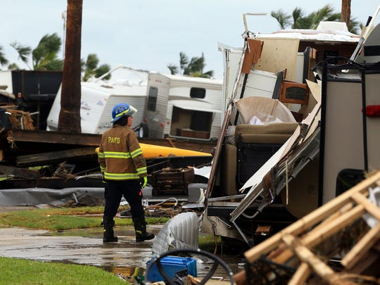 Port Aransas EMS Chief Tim McIntosh searches for stranded locals at an RV park after Hurricane Harvey landed in the Coast Bend area on Saturday, Aug. 26, 2017, in Port Aransas, Texas. after Hurricane Harvey landed in the Coast Bend area on Saturday, Aug. 26, 2017, in Port Aransas, Texas.