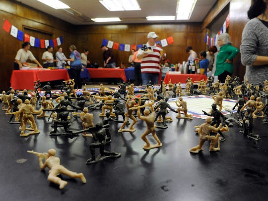 Plastic army men are arranged on a desk at Abilene